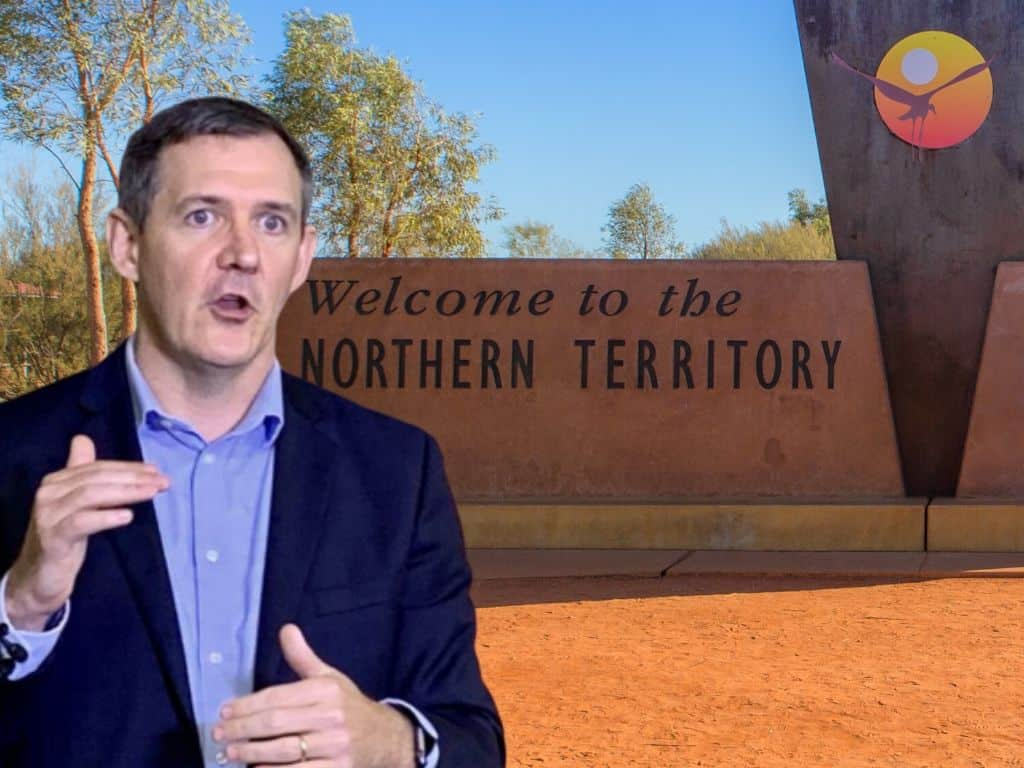 Michael Gunner with an image of the Northern Territory border